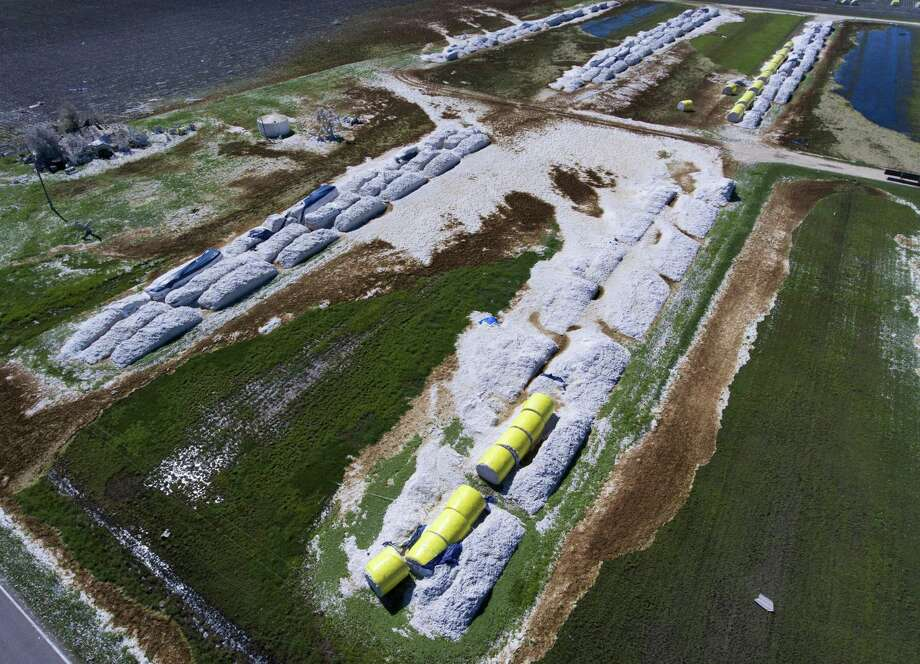 Rows of cotton modules lie destroyed near the Bayside-Richardson Co-Op Gin in Woodsboro Thursday Sept. 7, 2017, after Hurricane Harvey's winds damaged the gin beyond operation. Photo: William Luther /San Antonio Express-News / © 2017 San Antonio Express-News