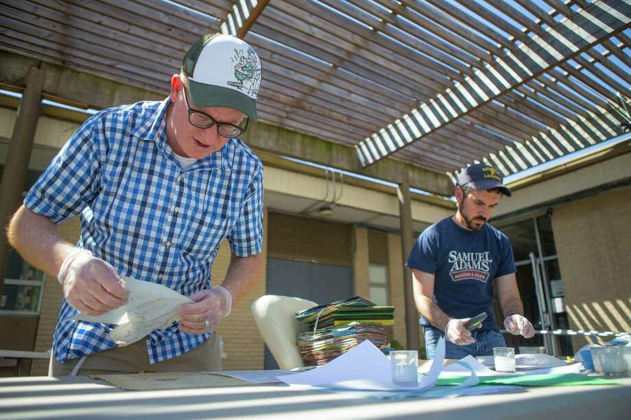United Orthodox Synagogues Rabbi Barry Gelman (left) and Josh Furman (right), a congregant and local historian, go through flooded files containing important records that were completely submerged in the Rabbi's office , Thursday, September 7, 2017. The synagogue on Greenwillow Street near Brays Bayou was flooded with multiple feet of water. Repairs are underway inside the building. Photo: Mark Mulligan, Mark Mulligan / Houston Chronicle / 2017 Mark Mulligan / Houston Chronicle