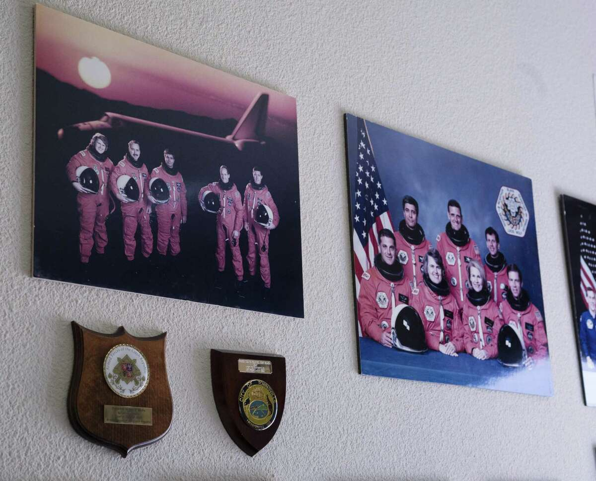 Photos and plaques belonging to former astronaut, Col. John Blaha (USAF ret.) at his home in Spring Branch.