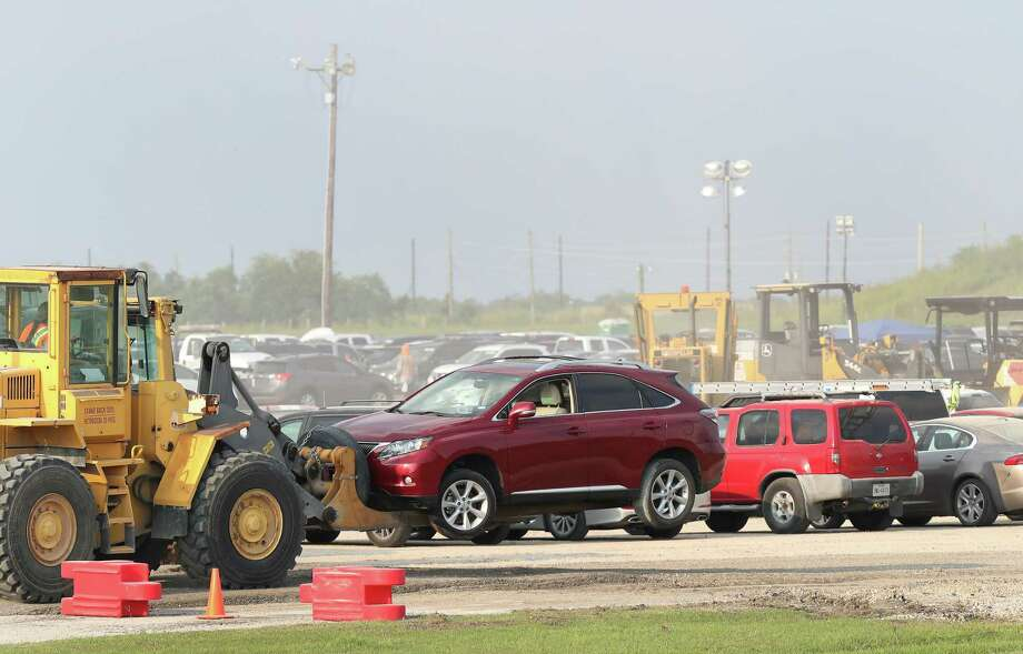 Thousands of flooded cars are now at the parking lot of the Royal Purple Raceway having adjusters look them over Sunday, Sept. 3, 2017, in Baytown. Photo: Steve Gonzales, Staff / © 2017 Houston Chronicle