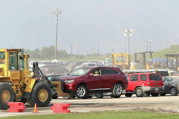 Thousands of flooded cars are now at the parking lot of the Royal Purple Raceway having adjusters look them over Sunday, Sept. 3, 2017, in Baytown.