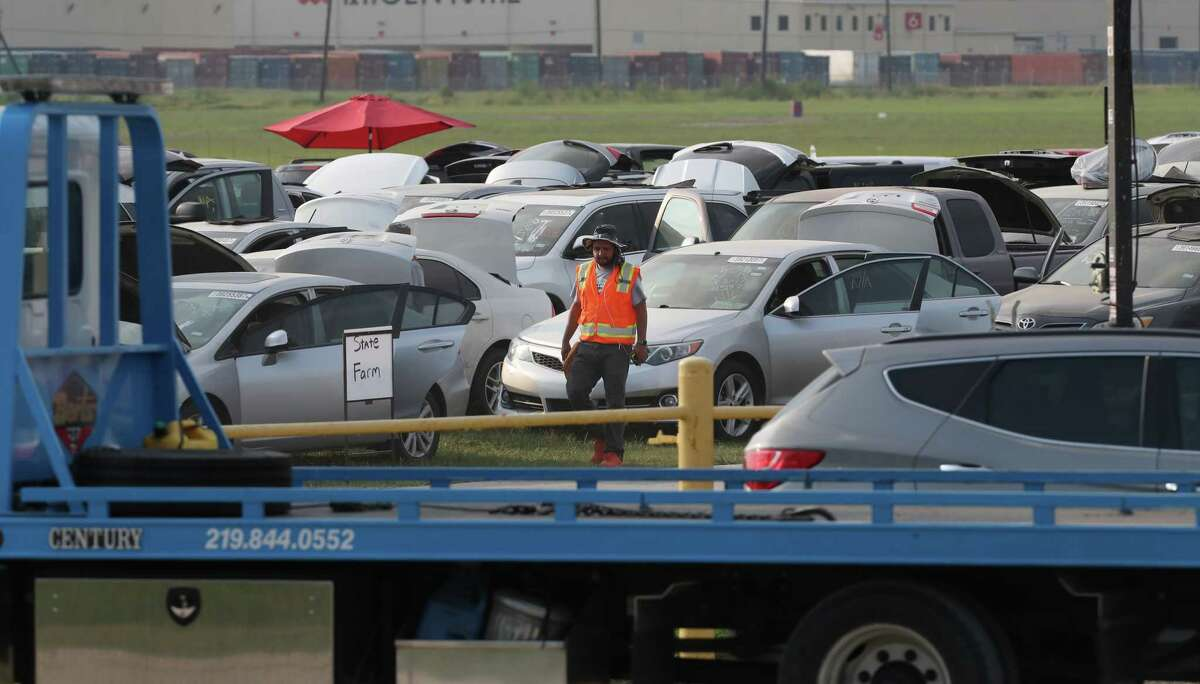 Thousands of flooded cars are now at the parking lot of the Royal Purple Raceway having adjusters look them over Sunday, Sept. 3, 2017, in Baytown. ( Steve Gonzales / Houston Chronicle )