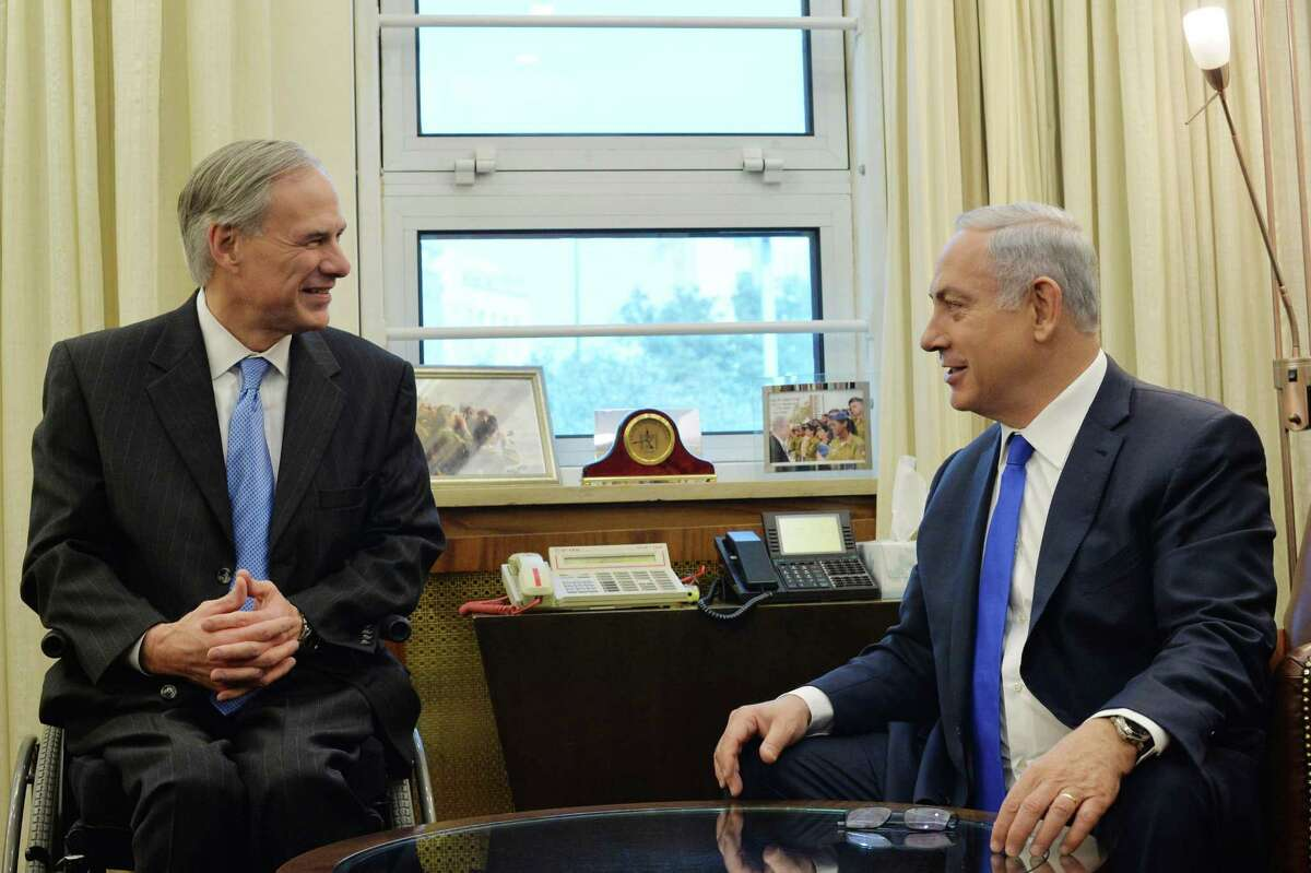 In this handout image provided by the Israeli Government Press office (GPO), Prime Minister Benjamin Netanyahu meets with Gregory Wayne Abbott, Governor of Texas at his office on January 18, 2016 in Jerusalem, Israel. (Photo by Kobi Gideon / GPO via Getty Images)