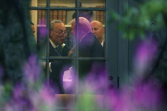 WASHINGTON, DC - SEPTEMBER 06:  U.S. Senate Minority Leader Chuck Schumer (D-NY) (L) makes a point to President Donald Trump in the Oval Office prior to his departure from the White House September 6, 2017 in Washington, DC. President Trump is traveling to North Dakota for a tax reform event with workers from the energy sector.  (Photo by Alex Wong/Getty Images) *** BESTPIX ***