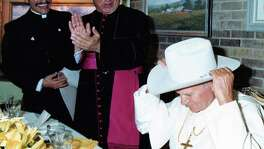 Pope John Paul II was presented with a Stetson cowboy hat at a luncheon with the Texas bishops. From the left: Fr. Michael Boulette, Archbishop Patrick Flores and Pope John Paull II.