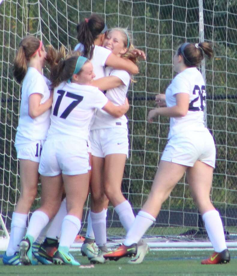The Immaculate High School girls soccer team celebrates a goal by Kayla Mingachos during its victory over Joel Barlow at Immaculate High School in Danbury Sept. 8, 2017. Photo: Richard Gregory / Richard Gregory