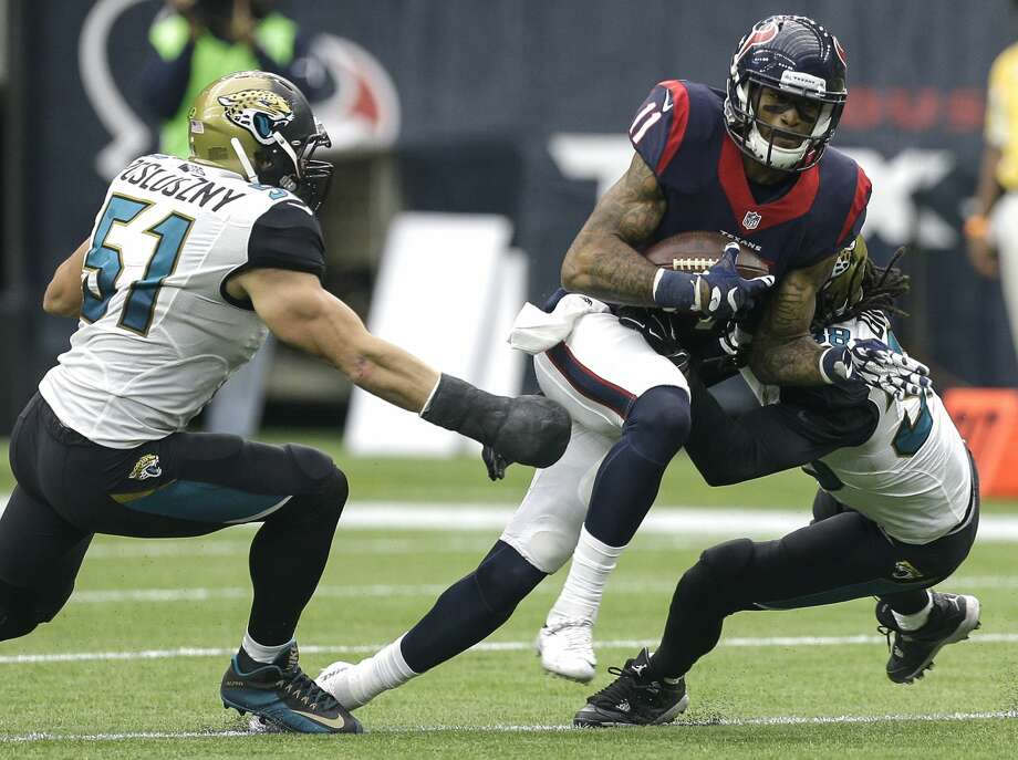 Houston Texans wide receiver Jaelen Strong (11) makes a catch between Jacksonville Jaguars middle linebacker Paul Posluszny (51) and free safety Sergio Brown (38) during the third quarter of an NFL football game at NRG Stadium on Sunday, Jan. 3, 2016, in Houston. ( Brett Coomer / Houston Chronicle ) Photo: Brett Coomer/Houston Chronicle