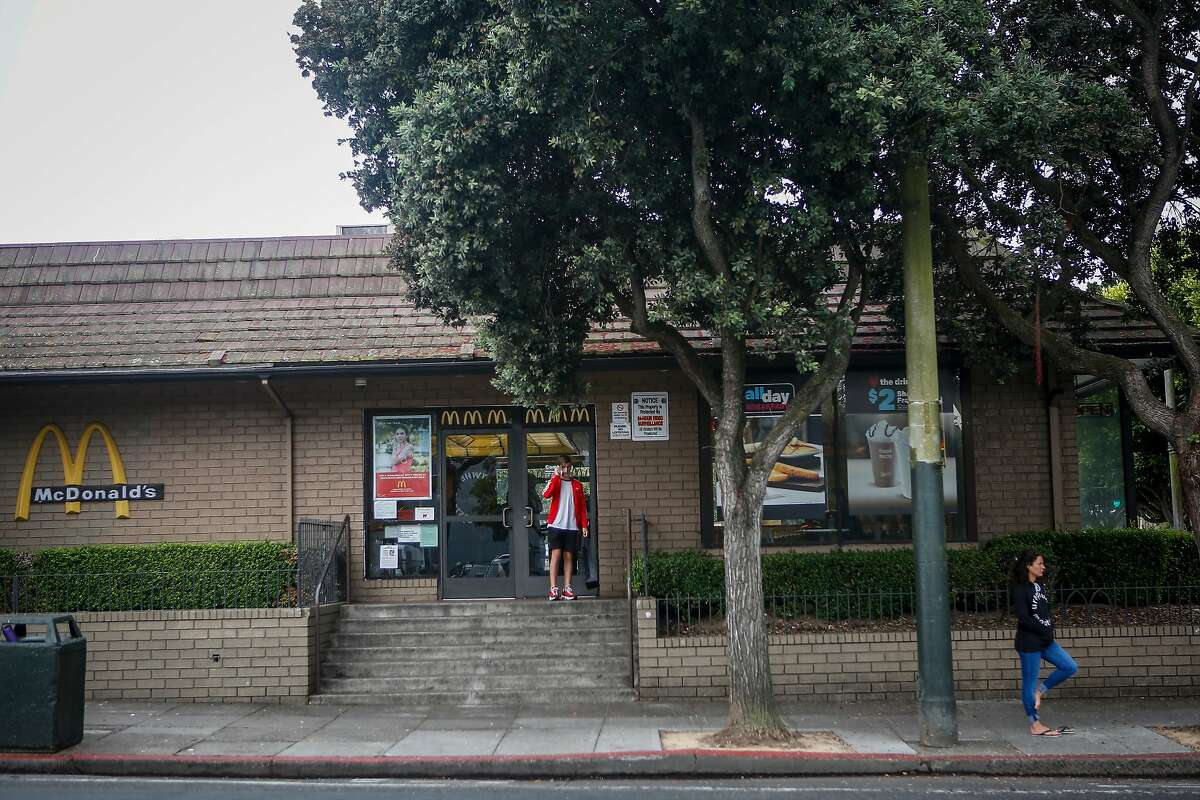 People walk past the McDonald's on Stanyon Street next to Golden Gate Park in San Francisco on Friday, August 4, 2017. The City of San Francisco has put in a bid to buy the McDonald's for affordable housing.