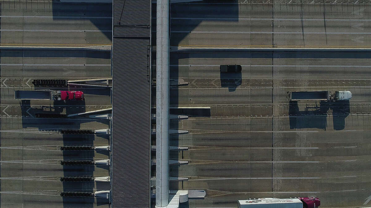 Traffic passes north on the West Sam Houston Tollway Thursday for the first time since flooding closed the tollway.