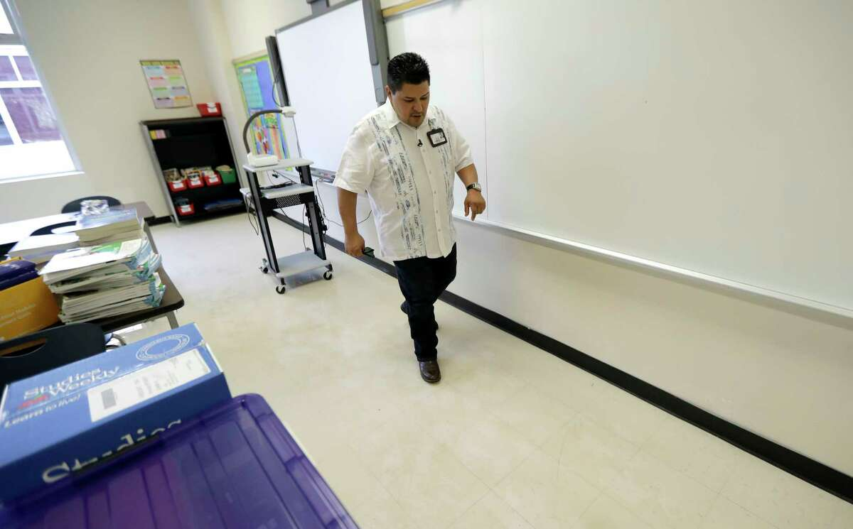 Houston Independent School District Superintendent Richard Carranza walks through a classroom damaged by floodwaters at A.G. Hilliard Elementary School in the aftermath of Hurricane Harvey. (AP Photo/David J. Phillip)