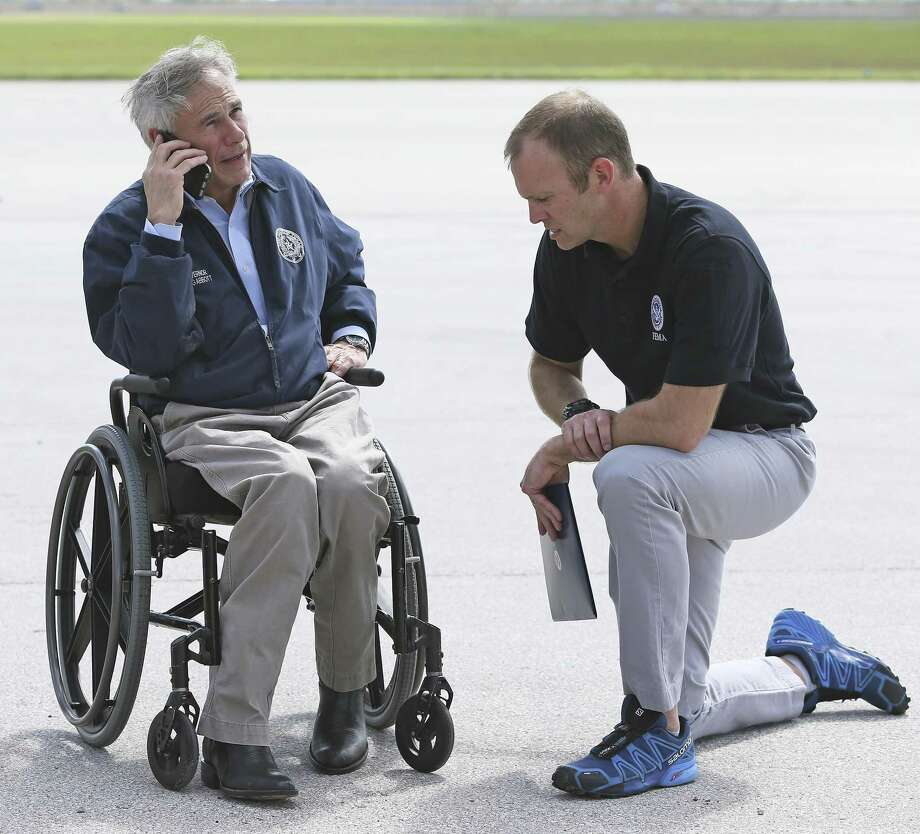 Gov. Greg Abbott talks with FEMA Director Brock Long as President Donald Trump arrives at the Corpus Christi International Airport on Aug. 29. With the agency likely to have two major disaster fronts simultaneously in Texas and Florida, anxieties are high that resources will be spread thin and people here will fall through the cracks. But major improvements within the agency, including technology, staffing and other post-Katrina reforms, means the double-deployment scenario isn't likely to cause big delays in relief for Texans. Photo: Tom Reel /San Antonio Express-News / 2017 SAN ANTONIO EXPRESS-NEWS