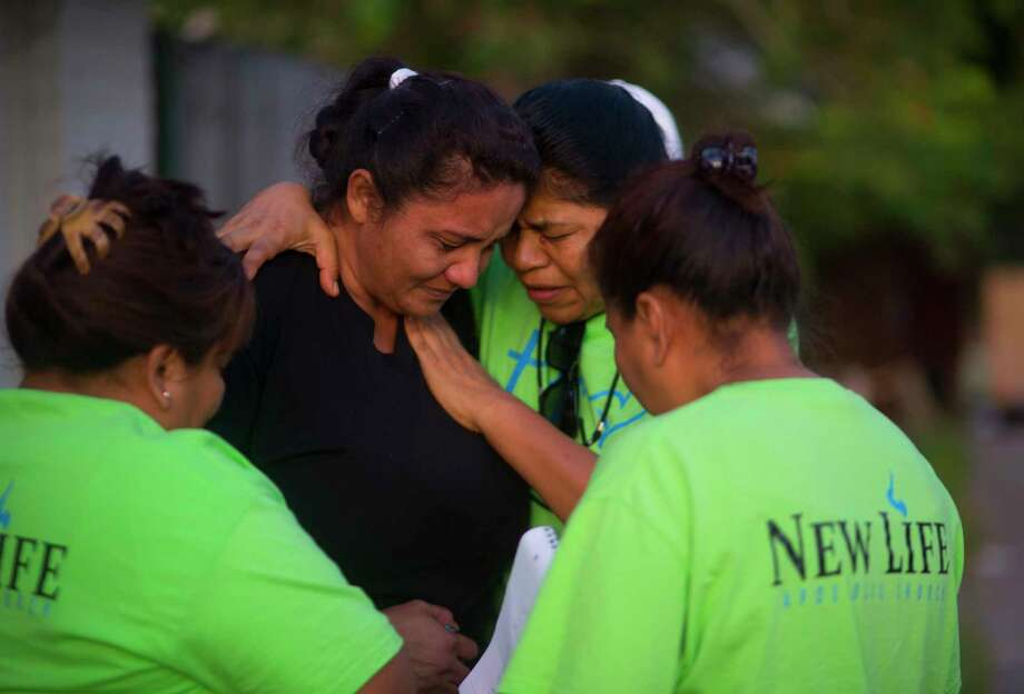 Emigdia G. Llmas hugs flood victim Berta Gomez while giving out supplies with fellow members of New Life Church in the Northshore neighborhood of Houston, Wednesday, September 6, 2017. Gomez escaped her apartment with her husband, 76-year-old mother and five-year-old daughter by wading through neck-deep water with helicopters flying overhead pointing the direction to go. She is currently waiting for a FEMA housing voucher to come through, but the process is taking a long time, she said. She is worried about her mother and daughter getting sick staying in their home. Photo: Mark Mulligan, Mark Mulligan / Houston Chronicle / 2017 Mark Mulligan / Houston Chronicle
