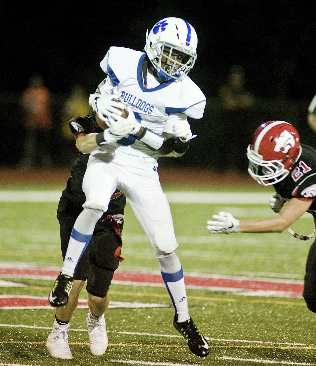 Bunnell High School's Elijah Alexandre comes down with the reception in a game against Masuk High School, played at Masuk. Friday, Sept. 8, 2017