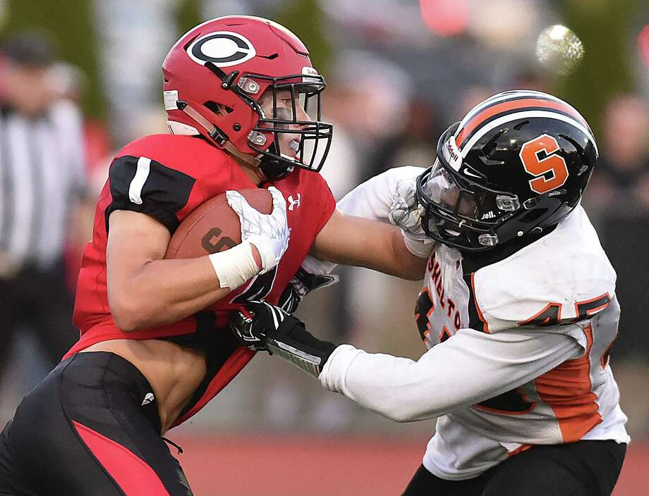 Shelton line backer Michai Lynch Barnes attepts to tackle Cheshire wide receiver Michael Jeffery, Friday, September 8, at Alumni Field at the David B. Maclary Athletic Complex in Cheshire. Cheshire won, 28-10. Photo: Catherine Avalone, Hearst Connecticut Media / New Haven Register