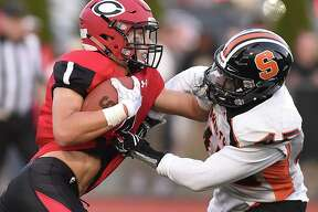 Shelton line backer Michai Lynch Barnes attepts to tackle Cheshire wide receiver Michael Jeffery, Friday, September 8, at Alumni Field at the David B. Maclary Athletic Complex in Cheshire. Cheshire won, 28-10.