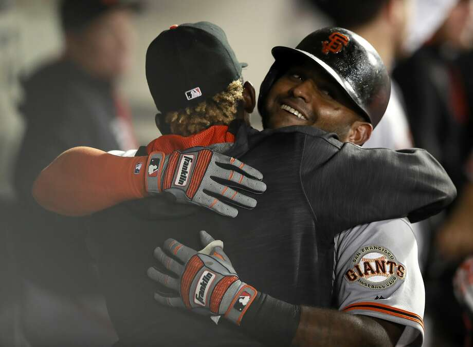Pablo Sandoval celebrates after hitting a three-run home run to end an 0-for-39 skid and get the Giants on the board. Photo: Jeff Haynes, Associated Press