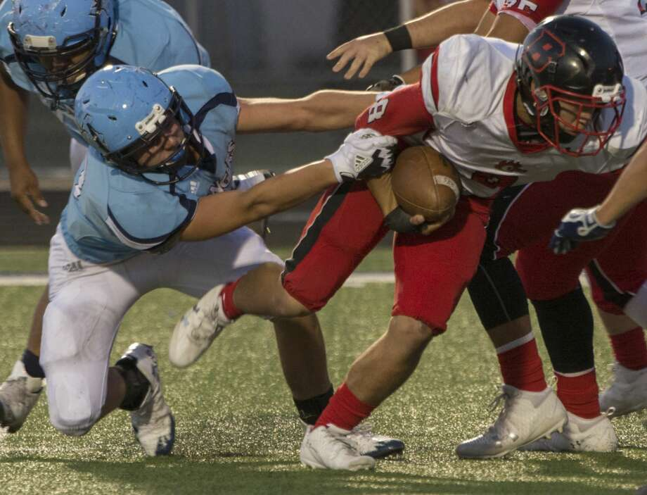 Greenwood's Jantzen Baker grabs Brownfield's Chili Morin in the backfield as he tries to pull him down 9/08/17 at J.M. King Stadium. Tim Fischer/Reporter-Telegram Photo: Tim Fischer/Midland Reporter-Telegram