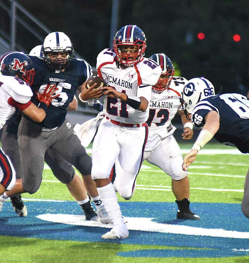 Brien McMahon quarterback Chris Druin runs for a gain during Friday's season-opening FCIAC game. Photo: John Nash / Hearst Connecticut Media / Norwalk Hour