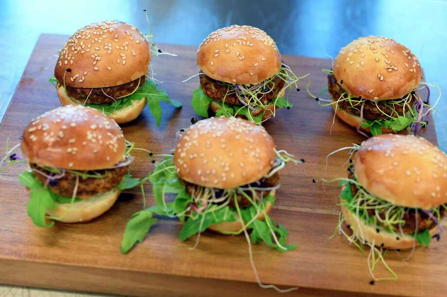 Swiss supermarket chain Coop has begun selling burgers made from insects. About one-third of the burger is mealworm larvae. Photo: Walter Bieri, SUB / © KEYSTONE / WALTER BIERI