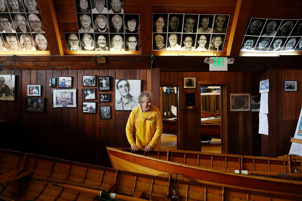 John Robiola returns a boat to its place in the Dolphin Club on Wednesday, September 6, 2017 in San Francisco, Calif.