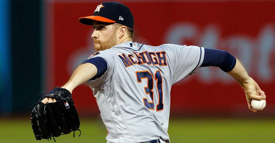 PHOTOS: Astros game-by-gameCollin McHugh was pulled after throwing his warmup pitches before the bottom of the fourth inning Friday with an apparent injury.Browse through the photos to see how the Astros have fared in each game this season. Photo: Jason O. Watson/Getty Images