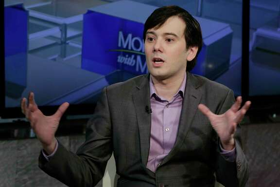 "FILE- In this Aug. 15, 2017, file photo, former pharmaceutical CEO Martin Shkreli speaks during an interview by Maria Bartiromo during her ""Mornings with Maria Bartiromo"" program on the Fox Business Network, in New York. Federal prosecutors have filed a court motion asking a judge to revoke Shkreli's bail and throw him in jail because of recent threats the so-called ""Pharma Bro"" allegedly made against Hillary Clinton. In their motion filed Thursday, Sept. 7, prosecutors said Shkreli posted on Facebook that he would pay $5,000 to anyone who grabs hair from Clinton during her book tour. (AP Photo/Richard Drew, File)"