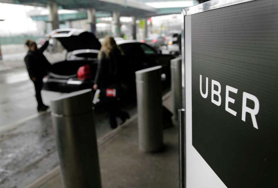 A sign marks a pickup point for the Uber car service at LaGuardia Airport in New York. Is Uber finally lowering the Jolly Roger, ending the rein of lawlessness where it showed complete disregard for local authorities, safety regulations and cultural norms?  Photo: Seth Wenig, STF / Copyright 2017 The Associated Press. All rights reserved.
