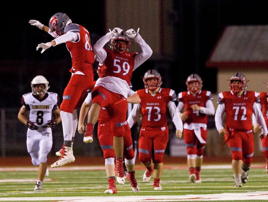 Splendora wide receiver Trey Wooldridge (84) celebrates with offensive linemen Matthew Morris (59) after catching a 40-yard pass during the fourth quarter of a non-district high school football game at Wildcat Stadium, Friday, Sept. 8, 2017, in Splendora. Photo: Jason Fochtman, Staff Photographer / © 2017 Houston Chronicle