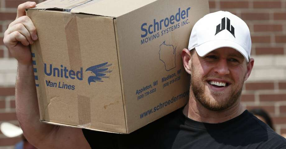 FILE - In this Sept. 3, 2017, file photo, Houston Texans defensive end J.J. Watt holds a box of relief supplies on his shoulder while handing them out to people impacted by Hurricane Harvey in Houston. Watt is being honored by the NFL Players Association after raising more than $29 million for Hurricane Harvey relief efforts. (Brett Coomer/Houston Chronicle via AP, Pool) Photo: Brett Coomer/Associated Press