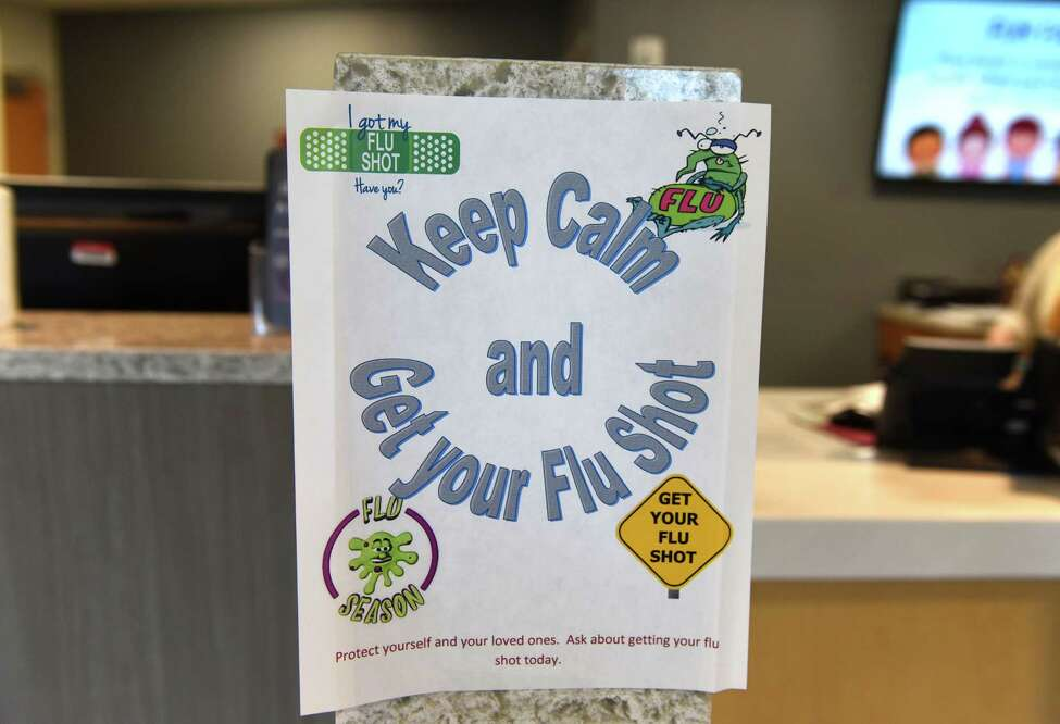 Flu shot sign in the lobby of Schodack Internal Medicine and Pediatrics on Friday morning, Sept. 8, 2017, in Schodack, N.Y. (Will Waldron/Times Union)