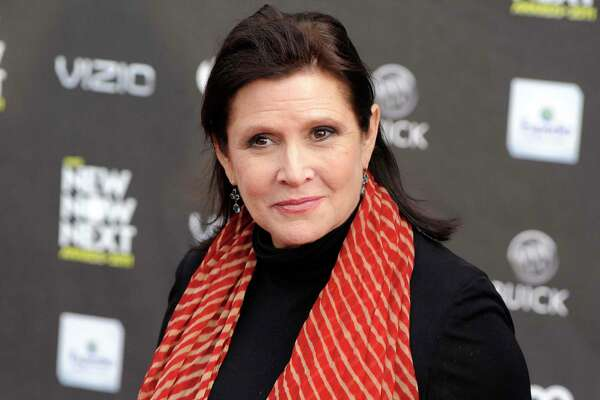 "FILE - This April 7, 2011, file photo, shows Carrie Fisher at the 2011 NewNowNext Awards in Los Angeles. Disney CEO Bob Iger said on March 23, 2017, that Fisher's performance as Princess Leia in ""The Last Jedi"" remains unchanged. Fisher completed filming her role as Princess Leia in ""The Last Jedi"" before her death following a heart attack in December. (AP Photo/Chris Pizzello, File) ORG XMIT: PAPM102"
