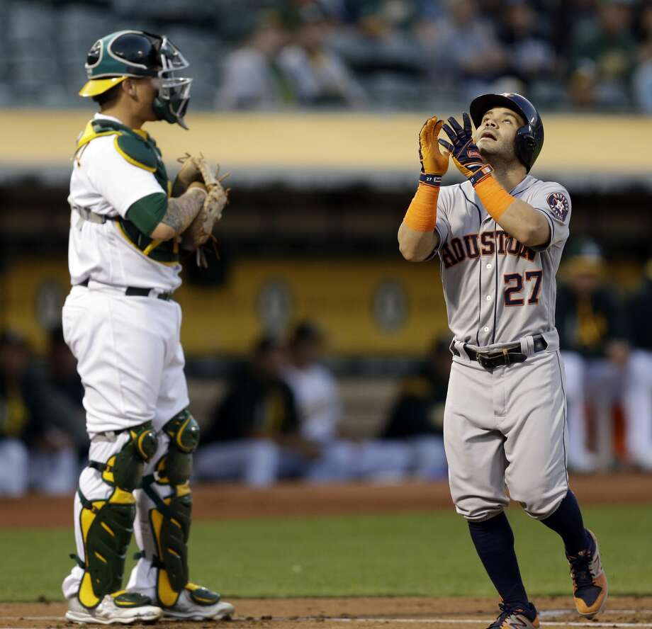 Houston Astros' Jose Altuve, right, celebrates in front Oakland Athletics catcher Bruce Maxwell after hitting a two-run home run off A's Jharel Cotton in the first inning of a baseball game Friday, Sept. 8, 2017, in Oakland, Calif. (AP Photo/Ben Margot) Photo: Ben Margot/Associated Press