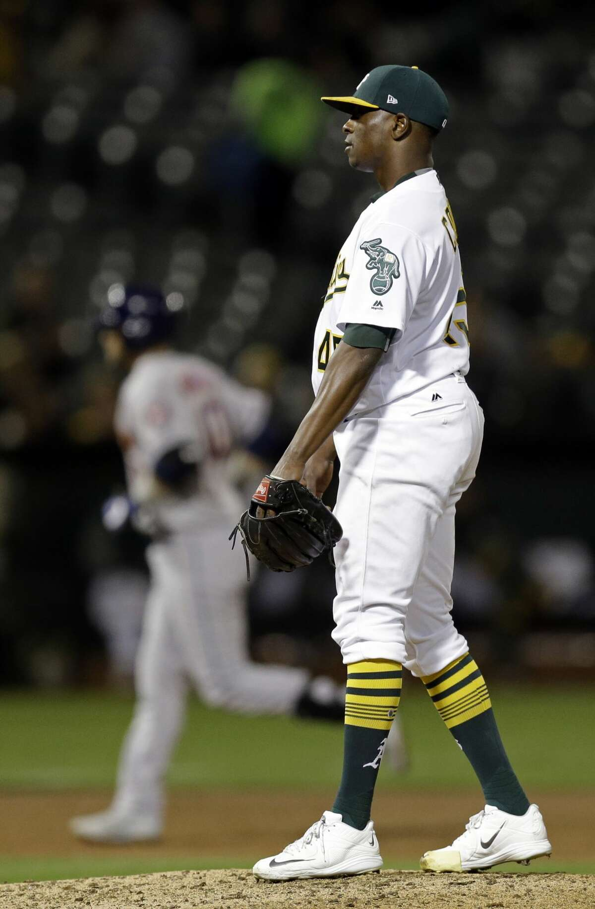 Oakland Athletics pitcher Jharel Cotton, right, waits for Houston Astros' Yuli Gurriel, left, to run the bases after hitting a two-run home run in the third inning of a baseball game Friday, Sept. 8, 2017, in Oakland, Calif. (AP Photo/Ben Margot)
