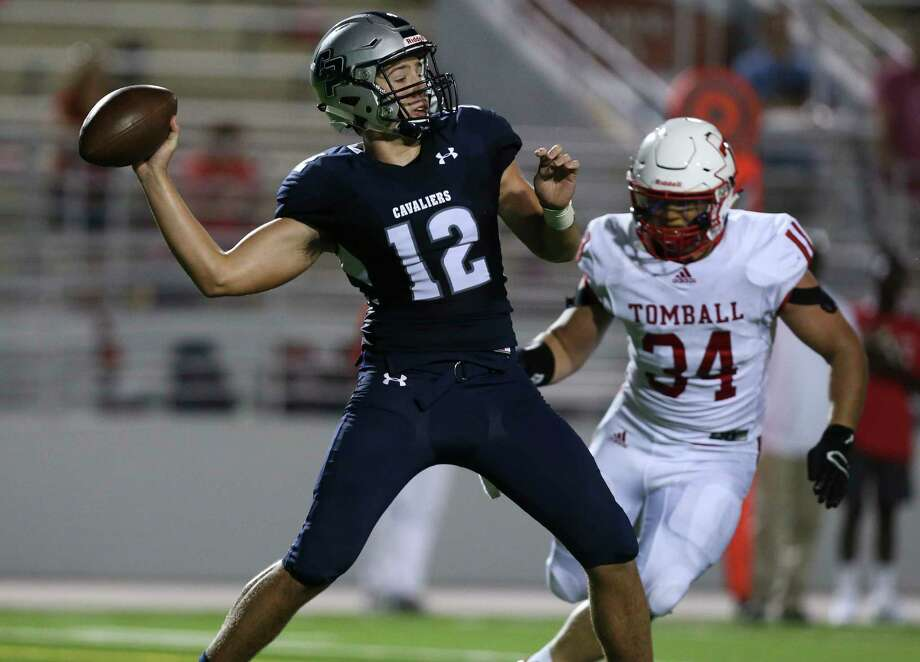 College Park's quarterback Jake Hunnicutt (12) makes a pass while Tomball's Dakota Stirman (34) is trying to sack him during the first half of the game at the Woodforest Bank Stadium Friday, Sept. 8, 2017, in The Woodlands. ( Yi-Chin Lee / Houston Chronicle ) Photo: Yi-Chin Lee, Staff / © 2017  Houston Chronicle