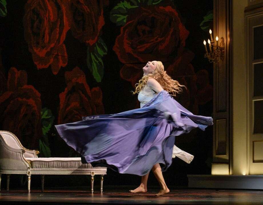 "Soprano Nadja Michael swirls onstage as Lady Macbeth in OPERA San Antonio's""Macbeth"" by Giuseppe Verdi. Photo: Karen Almond /Special To The Express-News"