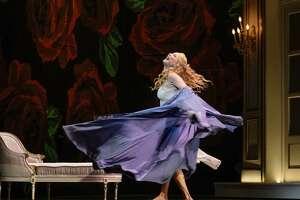 "Soprano Nadja Michael swirls onstage as Lady Macbeth in San Antonio Opera's ""Macbeth"" by Giuseppe Verdi."