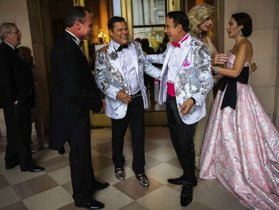 Mark Calvano (center) laughs as he realizes friend Joel Good rich wore the same dinner jacket as they arrive for the San Francisco Opera opener at the War Memorial Opera House. Photo: Gabrielle Lurie / The Chronicle / ONLINE_YES