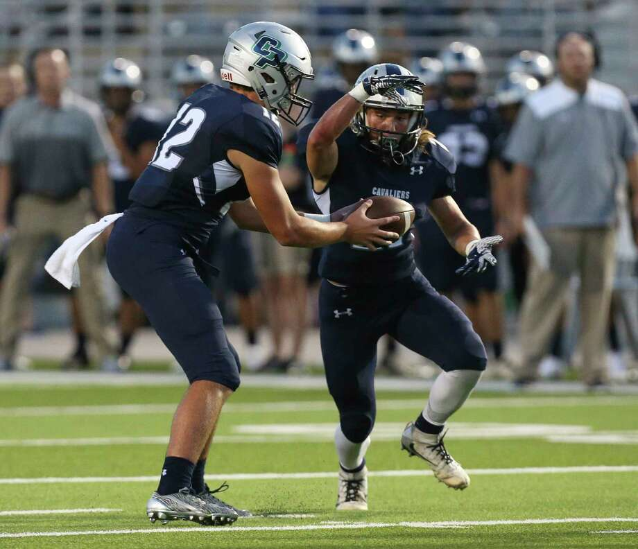 College Park's quarterback Jake Hunnicutt (12) hands the ball to running back Daniel Vann (21) during the first half of the game against Tomball at the Woodforest Bank Stadium Friday, Sept. 8, 2017, in The Woodlands. ( Yi-Chin Lee / Houston Chronicle ) Photo: Yi-Chin Lee, Staff / © 2017  Houston Chronicle