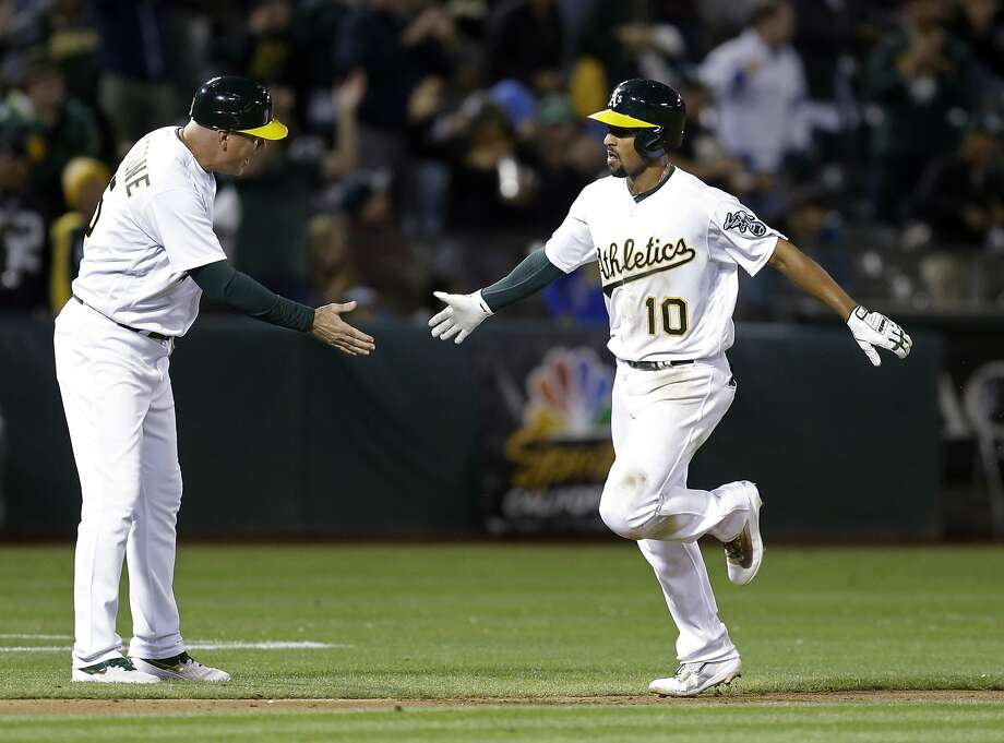 Oakland Athletics' Marcus Semien, right, is congratulated by third base coach Steve Scarsone after hitting a grand slam off Houston Astros' Luke Gregerson during the seventh inning of a baseball game Friday, Sept. 8, 2017, in Oakland, Calif. (AP Photo/Ben Margot)6 Photo: Ben Margot, Associated Press