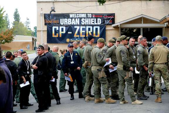 Attendees line up for a seminar during the opening day of Urban Shield at the Alameda County Fairgrounds in Pleasanton, Ca., on Fri. September 8, 2017.