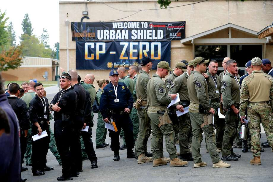 First responders line up to attend a seminar during the opening day of Urban Shield at the Alameda County Fairgrounds in Pleasanton in 2017. The law enforcement trainings will continue, but must change. Photo: Michael Macor / The Chronicle 2017