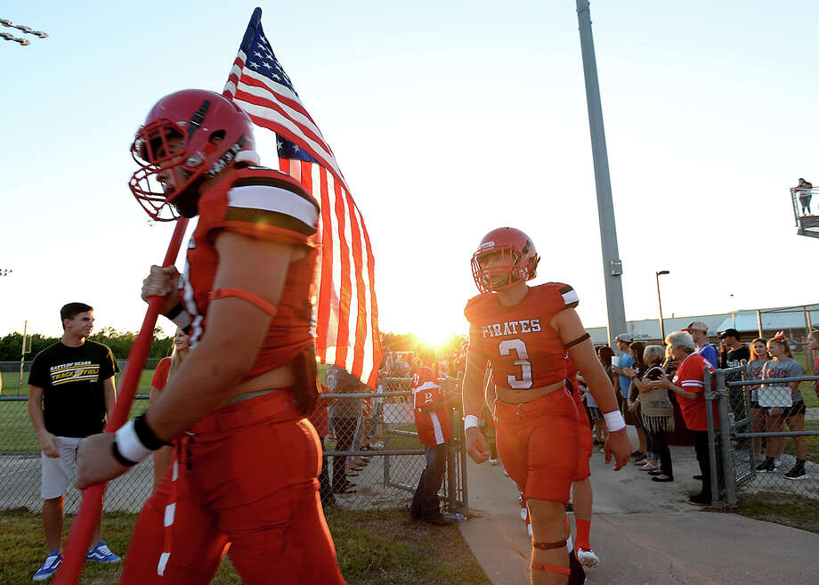 Deweyville make their way onto the field amid a line of fans as the area gets a taste of normal at Friday night's football game against Burkeville. Photo taken Friday, September 8, 2017 Kim Brent/The Enterprise Photo: Kim Brent / BEN