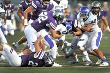 The Port Neches-Groves defensive unit swarms a Baytown Sterling runner during Friday's game at Indian Stadium in Port Neches. (Mike Tobias/The Enterprise)
