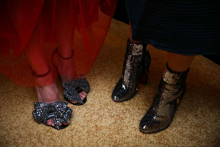 Jackie Pritzker shows off her Gucci shoes and Aimee Leroux shows off Louboutin boots whlie posing for a photo at the opening night of the San Francisco Opera in San Francisco, Calif., on Friday, Sept. 8, 2017.