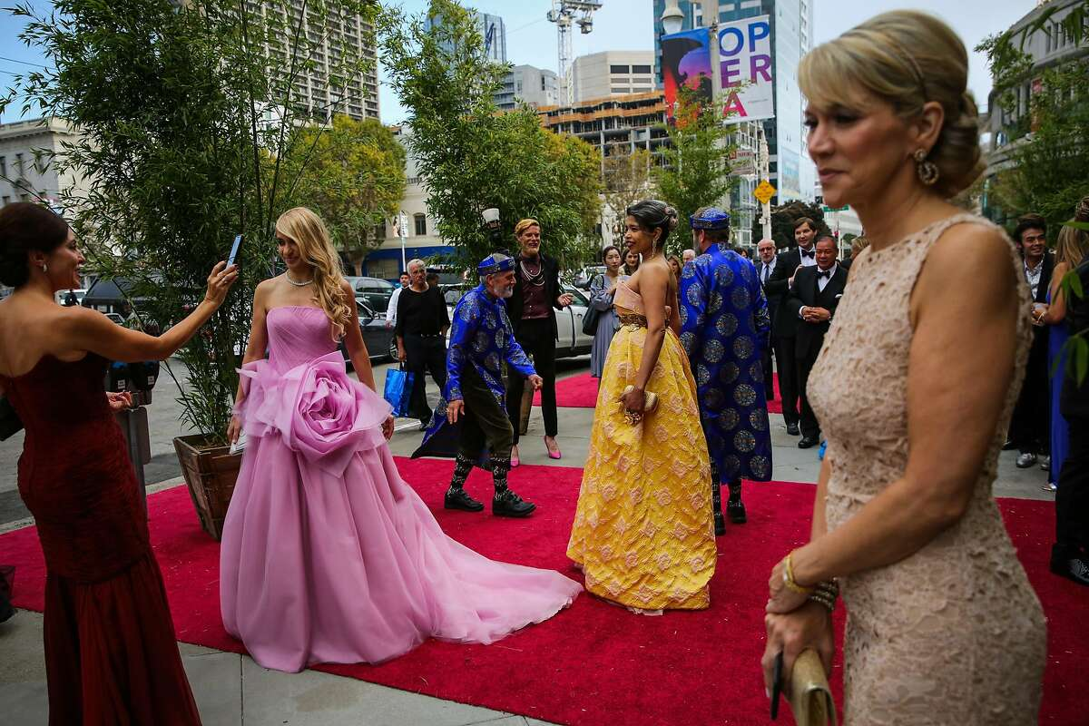 (l-r) Navid Armstrong (in pink) poses for a photo alongside Deepa Pakianathan (center,yellow) at the opening night of the San Francisco Opera in San Francisco, Calif., on Friday, Sept. 8, 2017.
