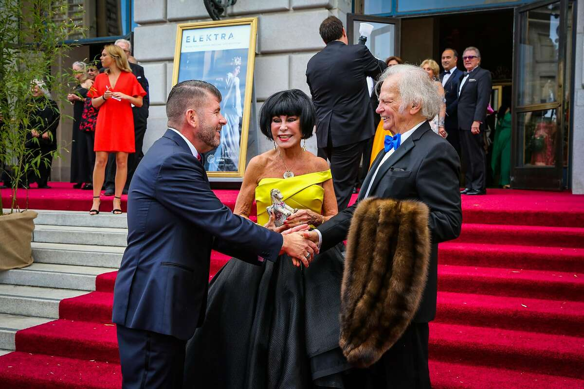 (l-r) Alan Morrell shakes hands with Michael Cabak while wife Marilyn Cabak (center) looks on at the opening night of the San Francisco Opera in San Francisco, Calif., on Friday, Sept. 8, 2017.