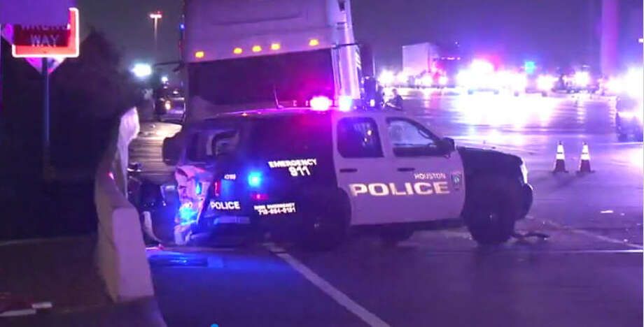 An officer blocking traffic from high water at the Eldridge Parkway exit on the Katy Freeway was struck Friday night, according to the Houston Police Department.  Photo: Metro Video