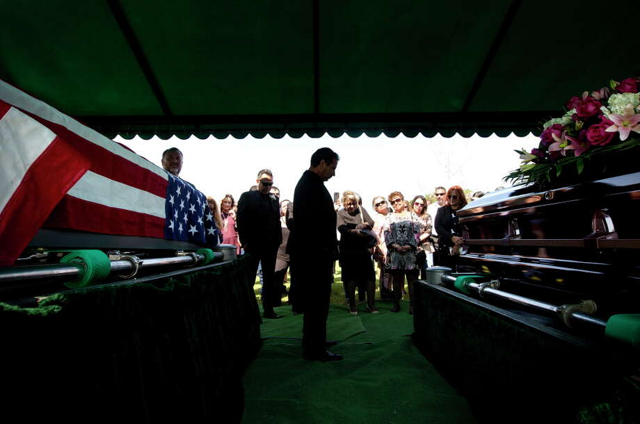 Ric Saldivar, center, recalls humorous stories about his parents, Belia Rojas Saldivar and Manuel Quintanilla Saldivar, Jr., during their funeral Saturday, Sept. 9, 2017, in Houston. The pair drowned along with four great-grand children in a van during flooding from Tropical Storm Harvey. Photo: Jon Shapley, Houston Chronicle / © 2017 Houston Chronicle