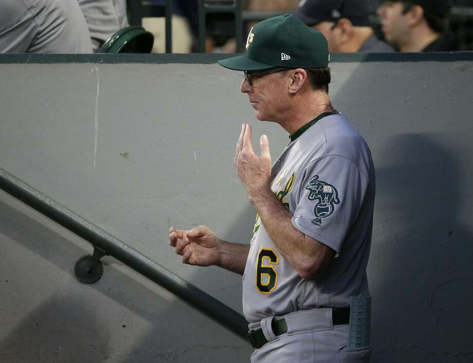 Oakland Athletics Bob Melvin signals a baserunner from the dugout during in the second inning of a baseball game against the Seattle Mariners, Friday, Sept. 1, 2017, in Seattle. (AP Photo/Ted S. Warren) Photo: Ted S. Warren, Associated Press