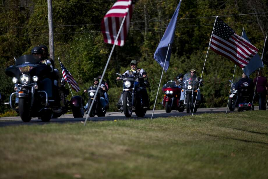 A brigade of motorcyclists pull into the American Legion Post in Sanford as they escort The Michigan Vietnam Veterans Traveling Memorial Wall and The Michigan Fallen Military Fallen Memorial Wall from Valley Plaza in Midland to the American Legion Post in Sanford Saturday, Sept. 9, 2017. (Josie Norris/for the Daily News) Photo: (Josie Norris/for The Daily News)